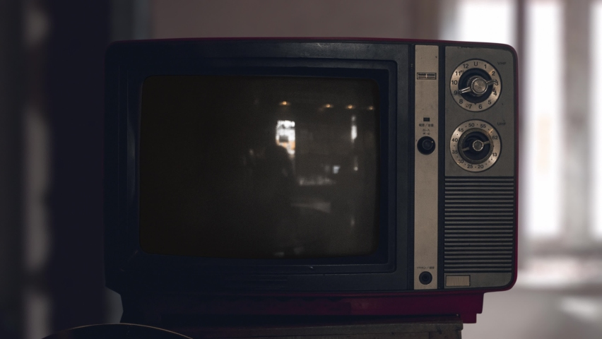Switch on tuning an old tube vintage TV set than switch off. Wooden style retro Tv set with switchers. Old Fashioned TV Turns On. Green screen chromakey. Reflections on screen | Shutterstock HD Video #1059205355