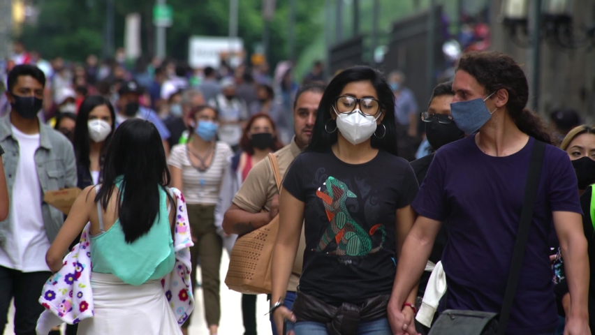 MEXICO CITY, SEPT 2020. A lot of people wearing face masks walk on the Madero street after authorities relaxed the restrictions about COVID 19, people try to return to their activities.