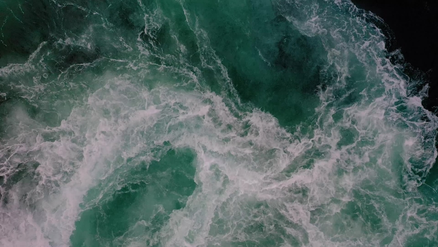 Waves of water of the river and the sea meet each other during high tide and low tide. Whirlpools of the maelstrom of Saltstraumen, Nordland, Norway   Shutterstock HD Video #1059210296