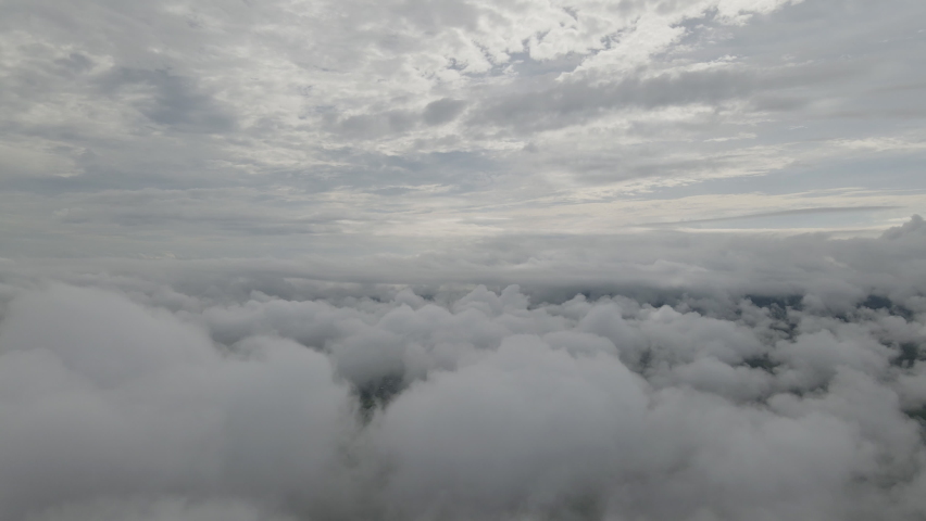 Flying through the amazingly beautiful cloudscape. Picturesque timelapse of white fluffy clouds moving softly on the clear blue sky. Direct view from the drone, Flying in The clouds. | Shutterstock HD Video #1059224618