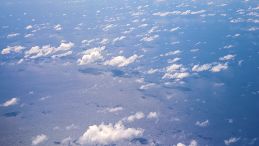 Ocean - September 19th 2020: Aerial footage of clouds. Turquoise water. Flight through clouds. Sky from the plane. Puffy cloud.