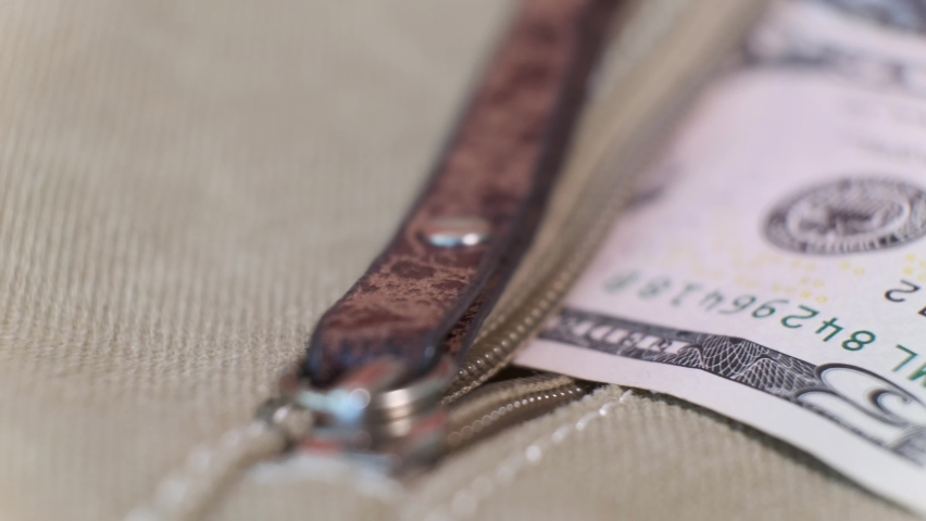 American Banknote of 5 Dollars and Plastic Credit Cards in canvas bag pocket on Rotating Table. Closeup, Shallow Depth of Field | Shutterstock HD Video #1059238208