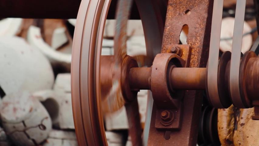 Closeup shot of leather belt in a machine | Shutterstock HD Video #1059238760