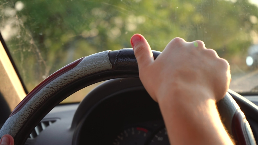 Man drives a car holding the steering wheel | Shutterstock HD Video #1059242672