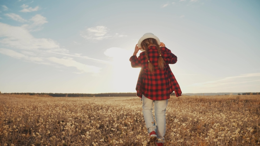 Little girl child walk in the park. kid dream happy family concept. daughter kid walk back outdoors sunlight. child walk with his back dream of happiness in family. people in lifestyle the park | Shutterstock HD Video #1059242774