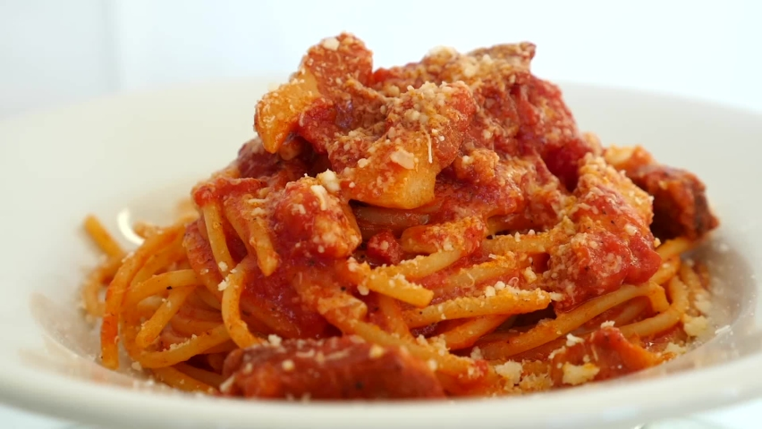 PLATE OF SPAGHETTI ALL'AMATRICIANA THAT TURNS ELECTRICALLY | Shutterstock HD Video #1059243143