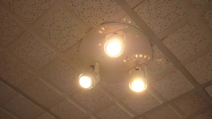 Set of ceiling lights turning OFF and ON. Closeup on the light bulbs. | Shutterstock HD Video #1059244730