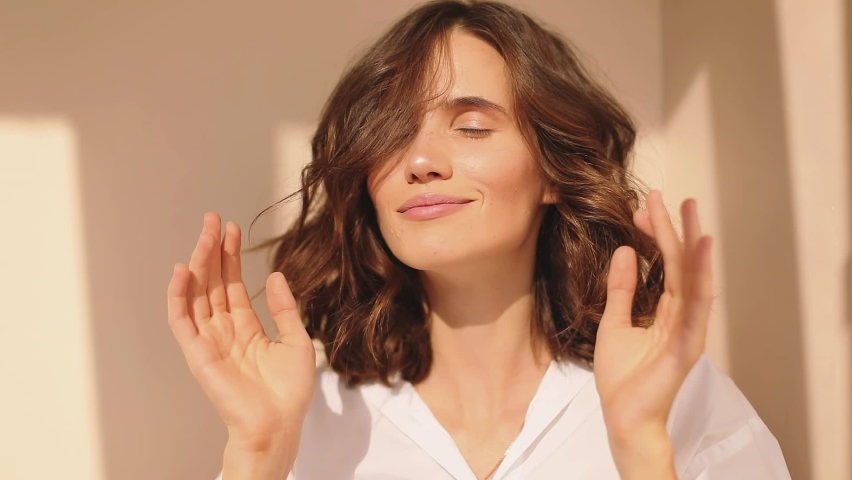 Face portrait of young natural beauty yogi woman hands gently folded in namaste gesture symbol of salutation and spirituality recognition of the unity and eternal spirituality of all things.  Royalty-Free Stock Footage #1059252287
