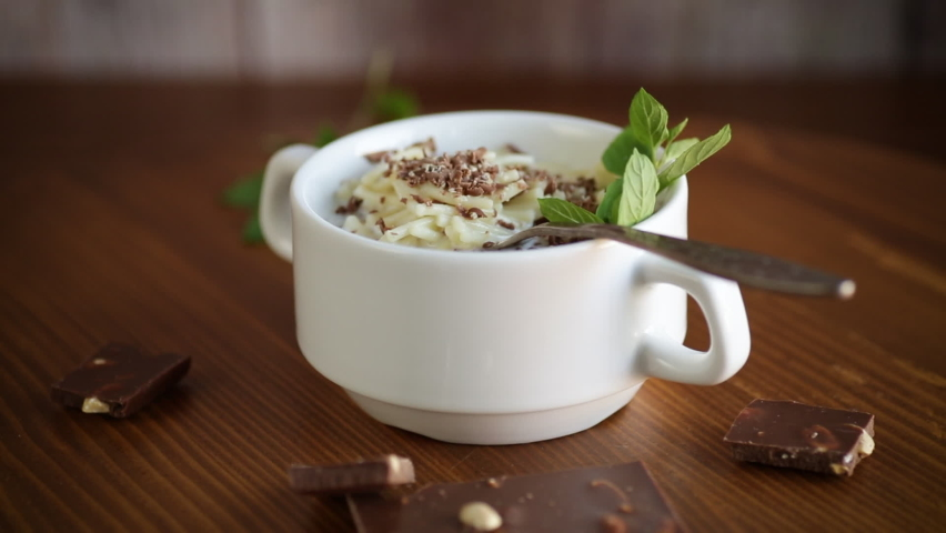 Sweet noodles with milk and grated chocolate in a bowl | Shutterstock HD Video #1059255074