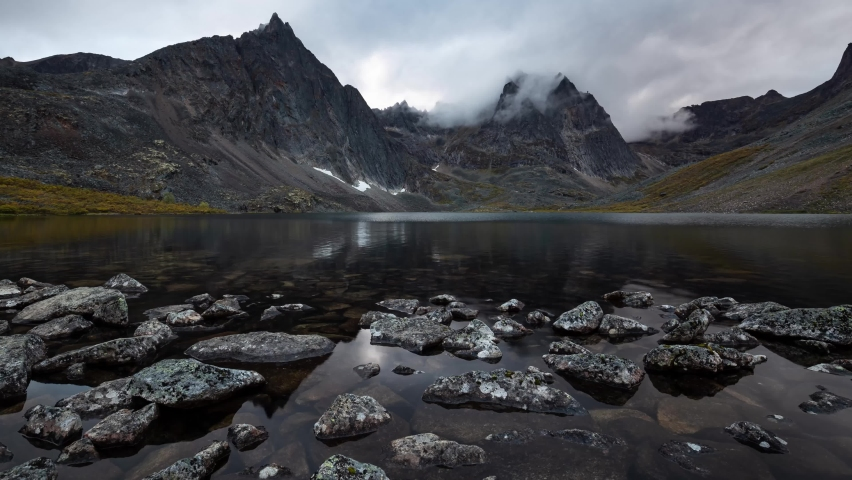 Grizzly Lake in Tombstone Territorial Park, Yukon, Canada. Cloudy Sunset Timelapse. Canadian Rocky Mountain Landscape. Colorful and Vibrant | Shutterstock HD Video #1059255536