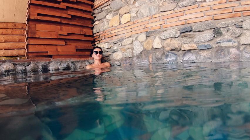 Happy woman enjoying in outdoor hot pool, spa | Shutterstock HD Video #1059255638