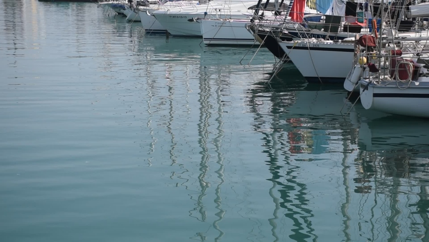 High quality video of a fishing port. Video of boats reflected in the water. | Shutterstock HD Video #1059256205