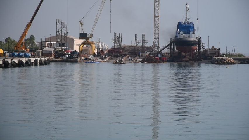 High quality video of a fishing port. Video of boats reflected in the water. | Shutterstock HD Video #1059256208