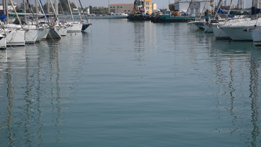 High quality video of a fishing port. Video of boats reflected in the water. | Shutterstock HD Video #1059256211