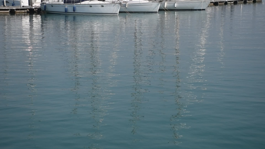 High quality video of a fishing port. Video of boats reflected in the water. | Shutterstock HD Video #1059256214