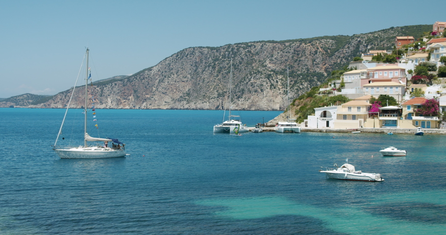 Assos village. Cephalonia island. Greece. Sea with yacht boats on summer vacation   Shutterstock HD Video #1059257720