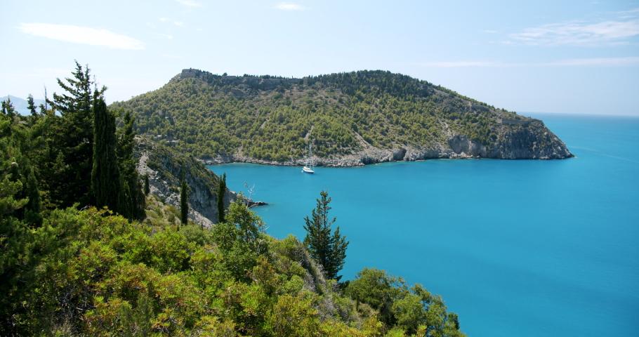 Lonely yacht boat in blue sea near Assos village on Kefalonia island. Greece.   Shutterstock HD Video #1059257723