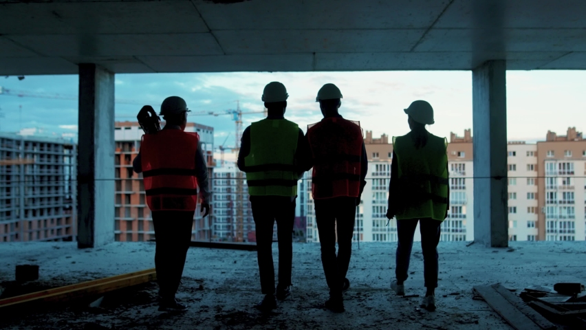View of shot back builders engineers workers in hard hat team walking on construction at sunlight survey urban meeting skyscraper builder architect contractor inspector construction helmet slow motion Royalty-Free Stock Footage #1059264587