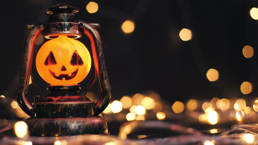 Halloween pumpkins on a horror black with light bokeh background. Holiday Halloween, Backdrop of halloween theme. copy space | Shutterstock HD Video #1059265397