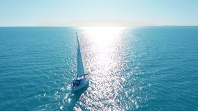 aerial view yacht sailing on opened sea sailing boat yachting video footage yacht from above sailboat view from drone
