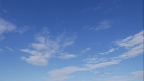 Blue sky white clouds. Puffy fluffy white clouds. Cumulus cloud scape timelapse. Summer blue sky time lapse. Dramatic majestic amazing blue sky. Soft white clouds form. Clouds time lapse background