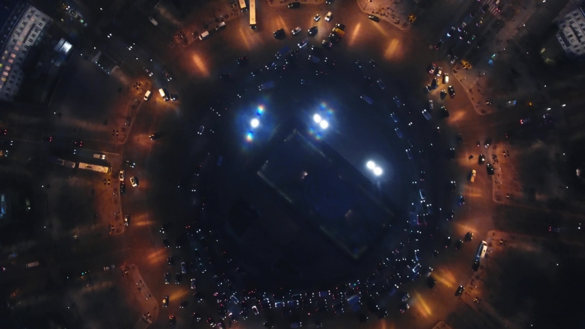 Aerial drone vertical view of Arc de Triomphe Triumphal Arch traffic intersection, Paris city attractions in France at night   Shutterstock HD Video #1059280709