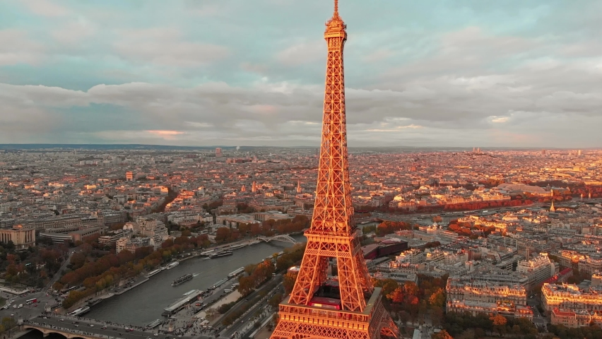 Aerial close up view of Paris Eiffel Tower Tour de Eiffel and panoramic view over Seine River and Paris city attractions at sunset | Shutterstock HD Video #1059280979