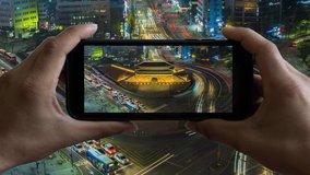 Animation of Touchscreen Smart Phone record video on time lapse. at namdaemun gate seoul city south korea.