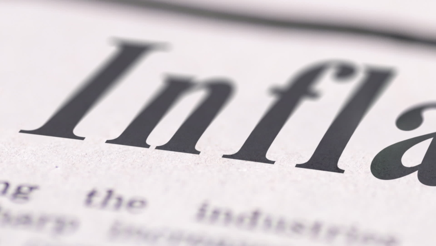 Close up footage of Inflation text written newspaper. | Shutterstock HD Video #1059297491