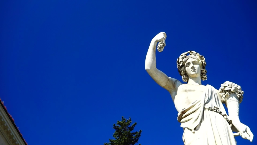 Marble statue with cornucopia at Piazza del Popolo in Rome seen from below with blue sky. copy space | Shutterstock HD Video #1059297596