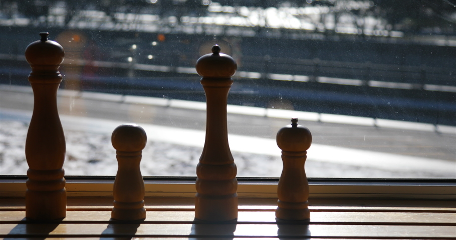 Wooden spice jars in the form of chess pieces. | Shutterstock HD Video #1059297956