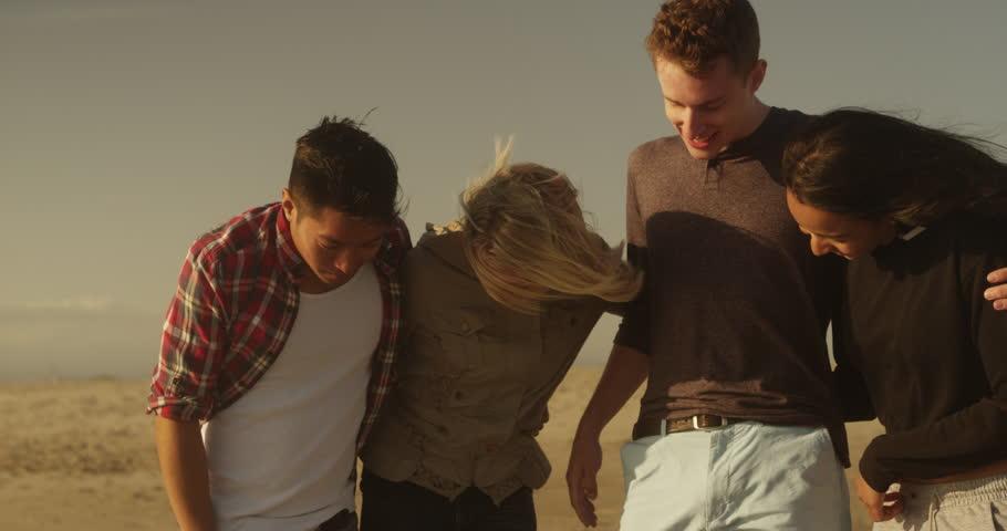 Friends using their feet to write on the beach | Shutterstock HD Video #10593101