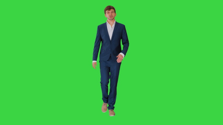 Businessman walking and explaining something to camera on a Green Screen, Chroma Key. | Shutterstock HD Video #1059356549