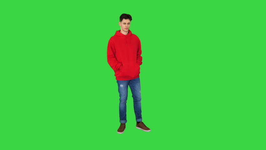 Successful young casual man receiving good news on the phone and dancing after this on a Green Screen, Chroma Key. | Shutterstock HD Video #1059356762
