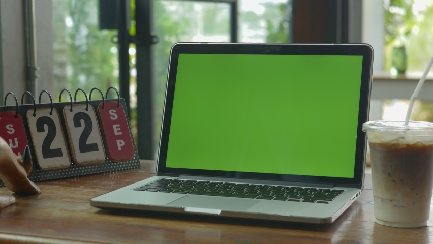 4K : A laptop computer with a key green screen set on work office table. | Shutterstock HD Video #1059361013