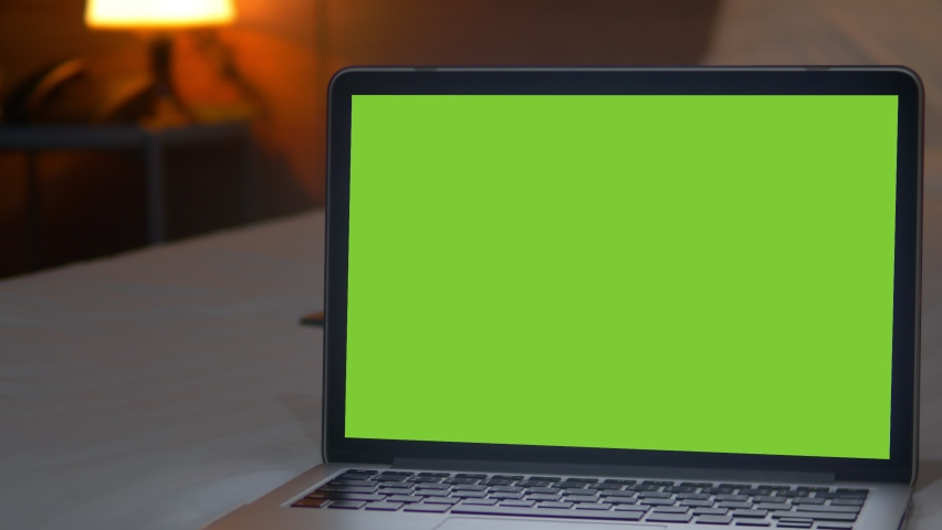 4K : A laptop computer with a key green screen set on work office table. | Shutterstock HD Video #1059361016