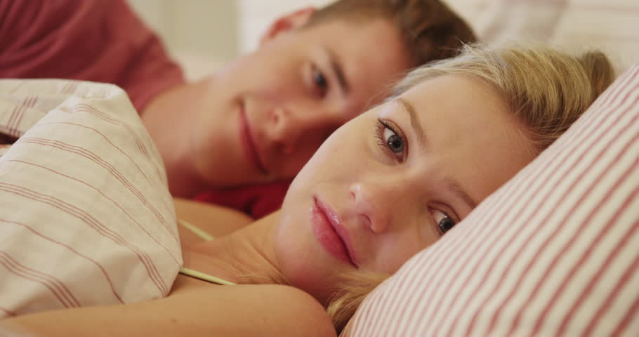 Young Couple Smiling in Bed Stock Footage Video (100% Royalty-free) 10594133 | Shutterstock