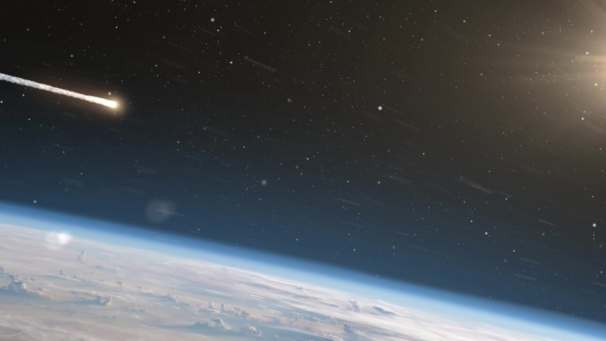 Asteroid Meteor Above Clouds and atmosphere Earth Meteor burning on fire while entering earth blue atmosphere