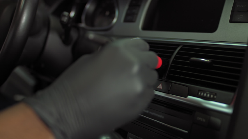 Young african american man wiping car interior, close up shooting hands, man wiping panel details with brush | Shutterstock HD Video #1059467300