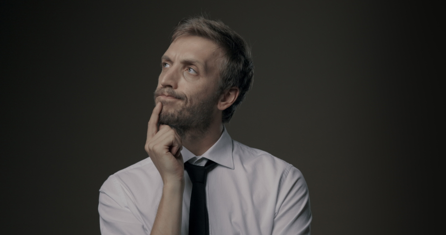 Pensive businessman thinking with hand on chin, problem solving and decisions concept Royalty-Free Stock Footage #1059484376