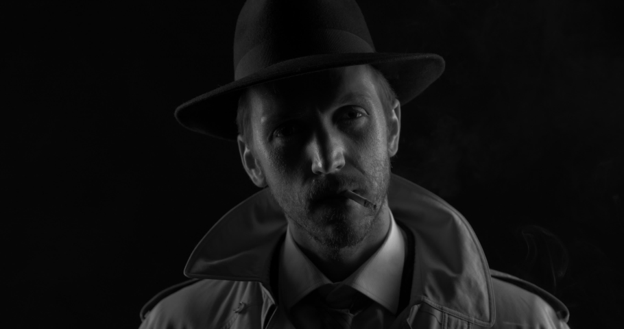 Noir film detective posing in the dark, he is smoking a cigarette