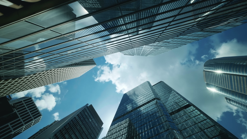 Time lapse of low angle view of city skyline buildings, blue sky and glass mirrored facades. | Shutterstock HD Video #1059505193