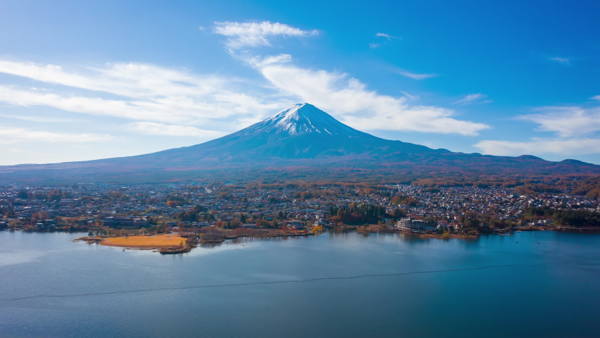 Aerial view Hyper lapse 4k footage of Mount Fuji on morning at Kawaguchiko Lake, Yamanashi, Japan. mt. fujisan hyperlapse by drone. | Shutterstock HD Video #1059516458