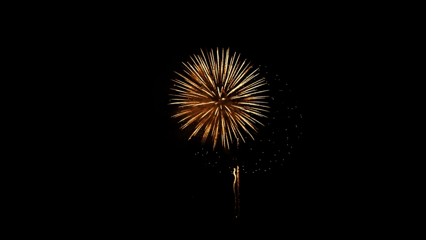 fireworks with bokeh lights in night sky. multicolored fireworks in night sky. glowing fireworks show. beautiful colored night . New year's eve shining fireworks celebration.  Royalty-Free Stock Footage #1059523025