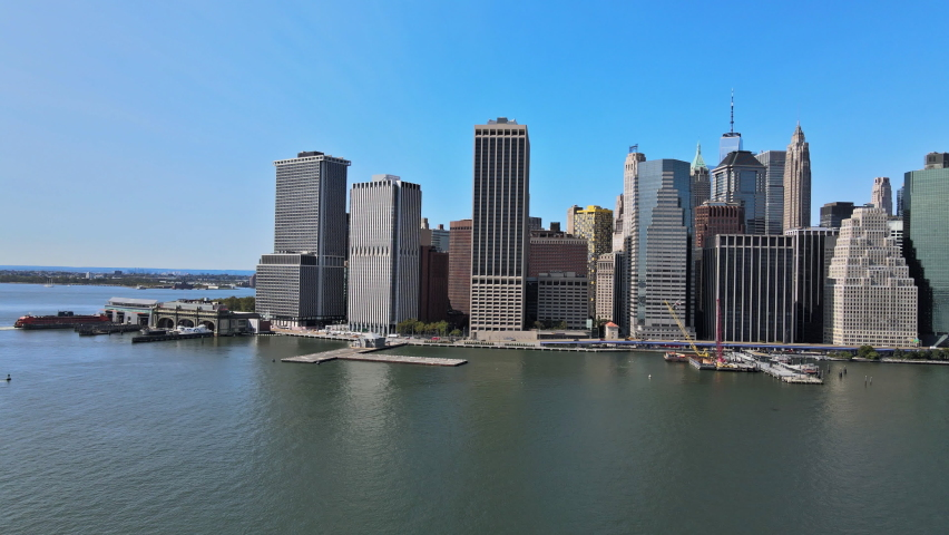 Aerial view of NYPD police helicopter over Manhattan from a height with East river financial district NYC USA