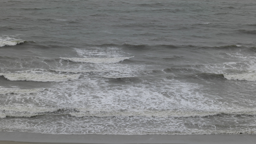 Waves crashing on a beach just before hurricane hits. Waiting for hurricane Isaias to arrive at North Myrtle Beach, South Carolina, U.S., on August 3, 2020.