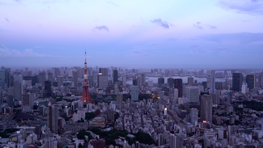 Tokyo Tower at dusk from high above, Wide panorama View in 4k