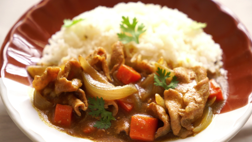 Japanese curry rice with sliced pork, carrot and onions   Shutterstock HD Video #1059564863