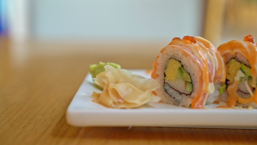 Salmon roll sushi with sauce on top - Japanese food style   Shutterstock HD Video #1059566027