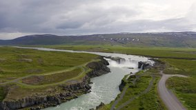 Aerial view of the Godafoss waterfall in Iceland. Godafoss means the waterfall of the gods in icelandic. 4K UHD video.